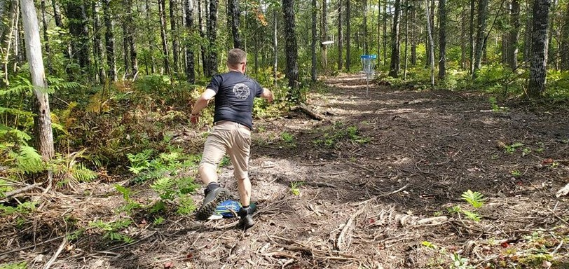 Troy Wallace takes in a round of disc golf at the new 18-hole course off McLeod Drive in Sussex. The course is officially open for people of all skill levels.