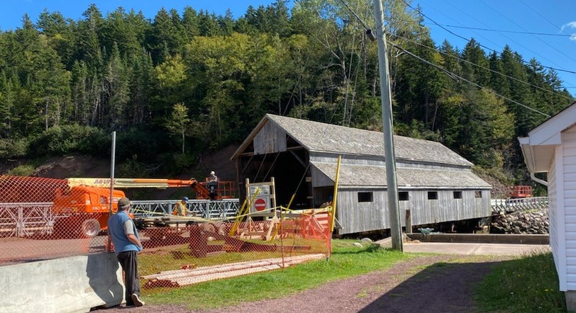 Crews began dismantling the Vaughan Creek Covered Bridge in St. Martins on Monday. The replacement is a modern wooden covered bridge designed to accommodate modern traffic.