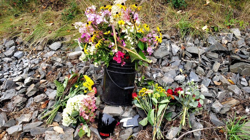 Flowers at the side of the road at the intersection of McLeod Hill Road and Hillview Drive in Fredericton where James Booker, a Grade 11 student at Fredericton Leo Hayes High School, was killed in a motor vehicle accident Wednesday.