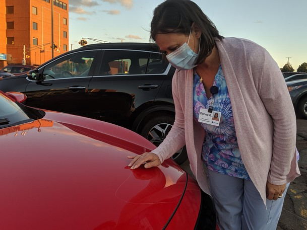 Donna Boosamra, a personal support worker at The Moncton Hospital, inspects the scratches on her brand new Honda outside the hospital. After coming out of a night shift on Sept. 20 she noticed someone had damaged her car and is not sure if it is a random incident or if she was targeted for being a health-care worker.