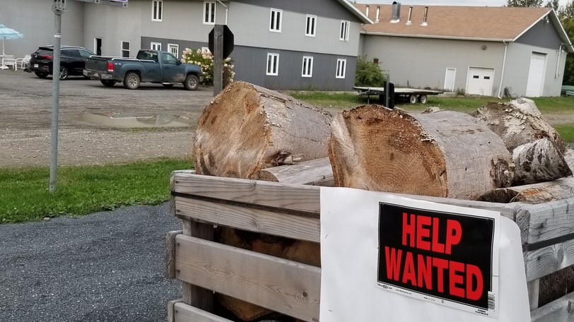 A help wanted sign outside the Bell Wire Products plant in Florenceville-Bristol. The manufacturer of Christmas wreath and floral wire products has decided all current and future employees must be fully vaccinated against COVID-19.