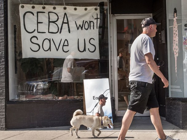 A store in Toronto displays a sign saying 'CEBA Won't Help Us' during the COVID-19 pandemic. A recent Equifax Canada survey suggested that most small business owners do not feel supported by their banks and government.