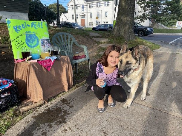Megan Kelly, 9, is hosting a juice stand to help her parents pay for Juno's cancer treatments.