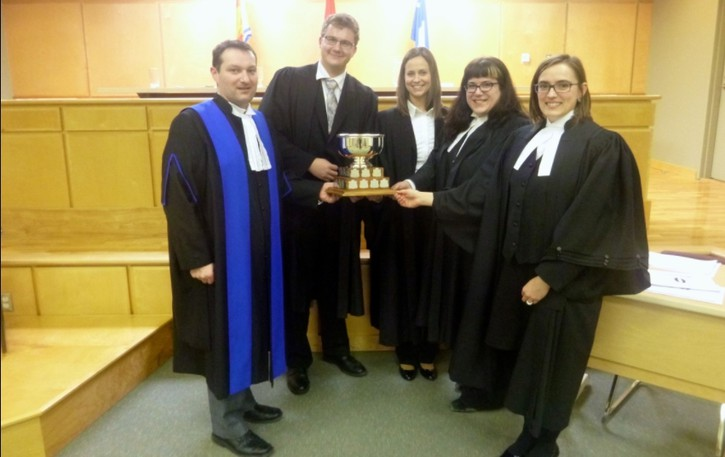 Provincial court judgeMarco Cloutier, left, has been named chief judge of the provincial courtof New Brunswick.