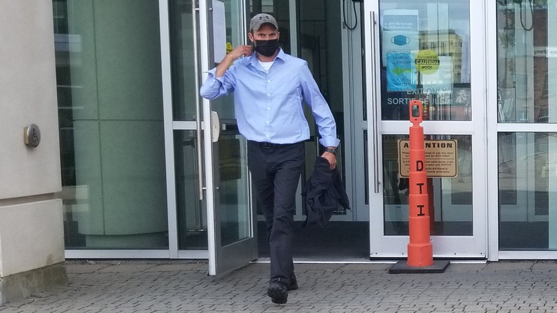 Blair Sheldon Harris leaves the Saint John Law Courts Tuesday.