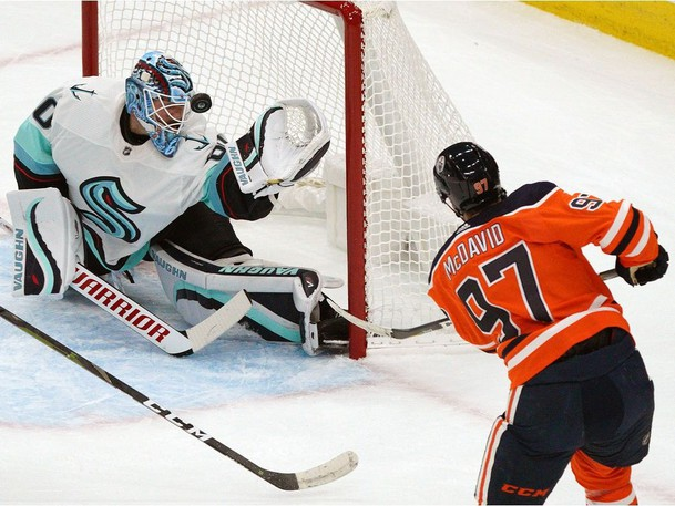 Seattle Kraken goalie Chris Driedger makes a save on Edmonton Oilers captain Connor McDavid during NHL pre-season action. Fredericton's Mike Clifford, associate editor for dobberhockey.com, says he'd pick McDavid to win the Art Ross Trophy every year, but believes Tampa Bay Lightning star Nikita Kucherov will keep him within his sights.