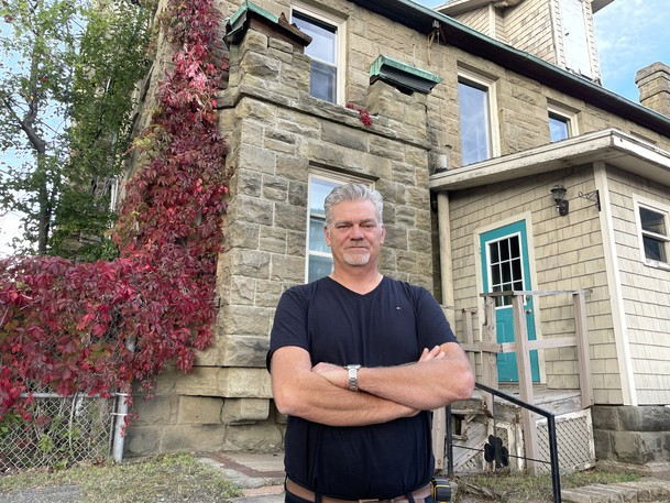 Paul Scharnberg, who is working to transform the former St. Bernard's Rectory into apartments. He's recently been frustrated by thefts of copper from the roof and trim of the historic building.