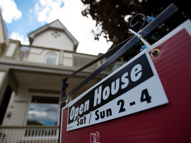 New Brunswick's record-breaking real estate market cooled off slightly in August, butCanada Mortgage and Housing Corporation (CMHC) is warning it may not be happening quickly enough in Moncton.