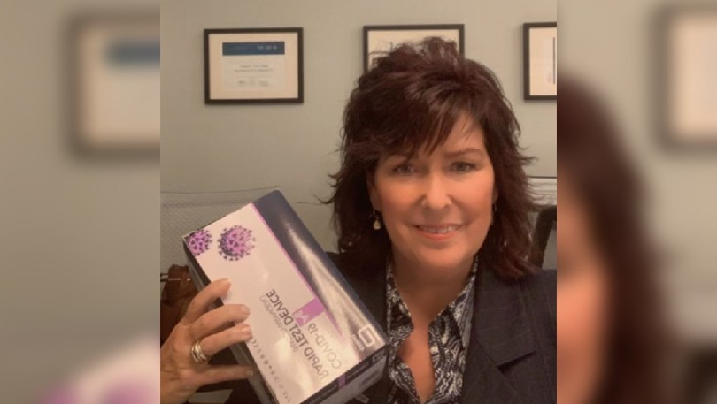 Deb Tremblay, manager of special projects for the Saint John Region Chamber of Commerce is shown with a COVID-19 rapid testing kit. The Chamber is coordinating the logistics of ordering the kits for smaller Chambers like the Sussex & District Chamber of Commerce.