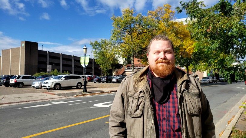 Trevor Dow, president of the Association of Professional Archeologists of New Brunswick, stands in front of the parking lot where the new $60-million provincial courthouse on King Street in Fredericton will be built.