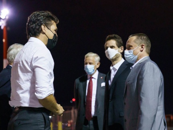 Michael Kovrig and Michael Spavor are greeted by Prime Minister Justin Trudeau after landing in Calgary, following nearly three years of detention in China, September 25, 2021.
