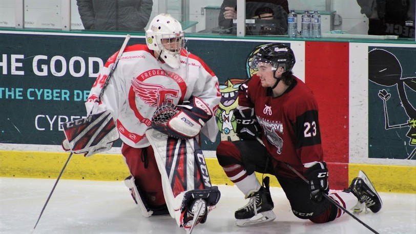 Fredericton Red Wings goaltender Morgan Kini and Miramichi Timberwolves forward Mason Beck, both from Bridgewater, N.S., chat before a Maritime Junior Hockey League game at the Grant-Harvey Centre on April 30. Kini has been dealt to the Wolves for future considerations.