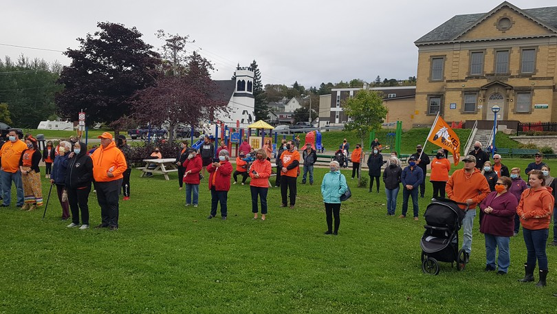 The crowd on hand at Dalhousie's Rotary Memorial Park on Sept. 30. They are wearing orange to honour those Indigenous children who suffered at the country's residential schools.