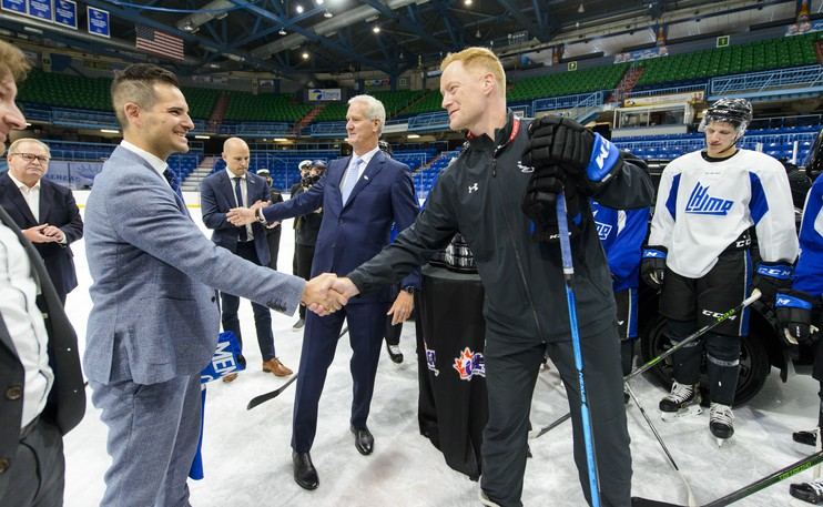 Saint John Sea Dogs president and general manager Trevor Georgie, left, shakes the hand of Gordie Dwyer, the Sea Dogs head coach last week at TD Station as the franchise celebrated winning the right to host the 2022 Memorial Cup next June.