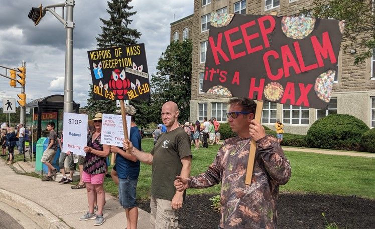 Anti-vaccination protesters gathered at the Dr. Georges-L.-Dumont University Hospital Centre in Moncton on Sept. 1 to protest mandatory vaccine passports in the province.