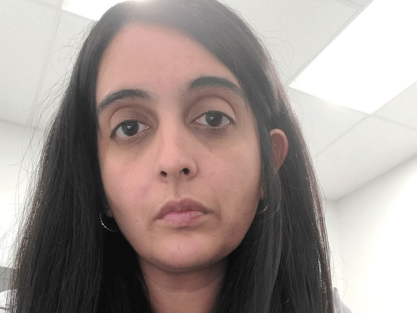 """Dr. Neeja Bakshi posted this photo to Twitter September 28, 2021 with the tweet """"This is the face of defeat. And anger. We care deeply for our trade. For being able to provide standards of care to our patients. Right now, we can't do that. Because @jkenneyputs self-preservation over the health and wellbeing of this province. My colleagues, I see you."""""""