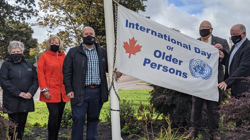 A flag-raising was held in Riverview Friday morning to recognize Oct. 1 as International Older Persons Day. From left to right are seniors rights advocate Cecile Cassista, Senator Nancy Hartling, Riverview Mayor Andrew J. LeBlanc, senors committee chairperson Gerry Forsythe and Bruce Fitch, Riverview MLA and Minister of Social Development.