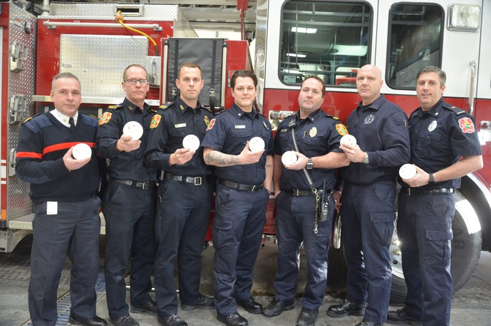 Members of the Miramichi Fire Department hold up smoke alarms as part of an awareness campaign in this file photo. The theme of this year's Fire Prevention Week, from Oct. 3 to 9, is Know the Sounds of Fire Safety. Pictured from left are deputy chief Mario Berthiaume, Lt. Wayne Falconer, fire prevention officer Corey Shaddick, firefighter Danton Hambrook, Lt. Frank Roche, Capt. Tony Traer and firefighter Wally MacTavish.
