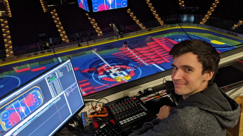 Olivier Dupuis-Nadeau, a technician with Solotech in Montreal, looks down on the ice surface of Moncton's Avenir Centre Friday while doing a run-through of a 3D video that will be shown during the Wildcats home opener game Saturday. Game time is 7 p.m. and fans are asked to be in their seats by 6:45 p.m.
