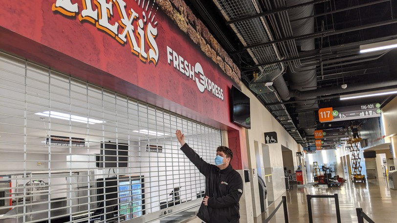 Chris McEachern, director of food and beverage service at the Avenir Centre, points out the new Mexi's food kiosk on the upper concourse level. Mexi's and Candy Depot are new vendors for this year.