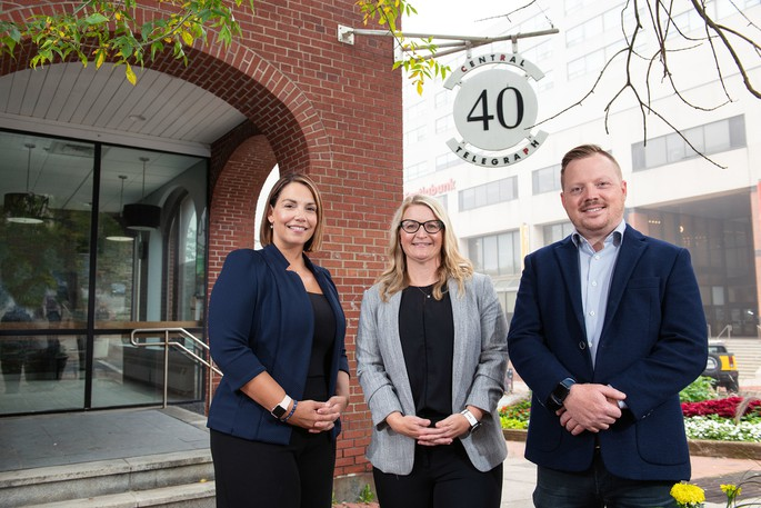 Ginger Agency co-CEO Kerry Wells, Saint John regional vice-president Amanda Masters and co-CEO and founder Andrew Belford at their new location at 40 King Street.