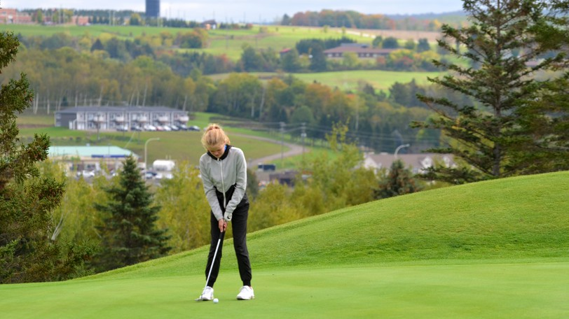 Rothesay High student Sarah Reevey puts on the green of hole one at the Covered Bridge Golf and Country Club.