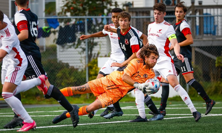 UNB Reds keeper Louis-Charles Vaillancourt dives to make one of his 10 saves during Saturday's 3-1 loss at Memorial.