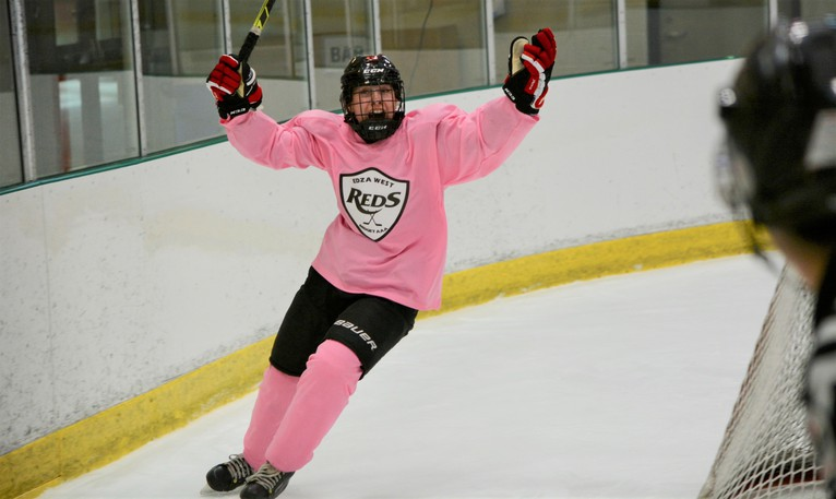"""EDZA West TNT Reds forward Maddy Budrow celebrates scoring her second goal in Saturday's 3-1 win over the Halifax Western Capitals in Maritime Major Under-18 Female Hockey League action. It was the Reds' """"Pink in the Rink"""" game to raise funds and awareness for breast cancer."""