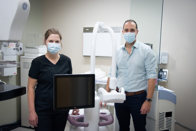 Myriam Lévesque, diagnostic imaging technologist, and Dr. Denis Thériault, head of diagnostic imaging in the Acadie-Bathurst health zone, pose for a photo  with the breast ultrasound machine purchased with funds from last year's Roses Radiothon. The annual fundraiser is underway for this year.