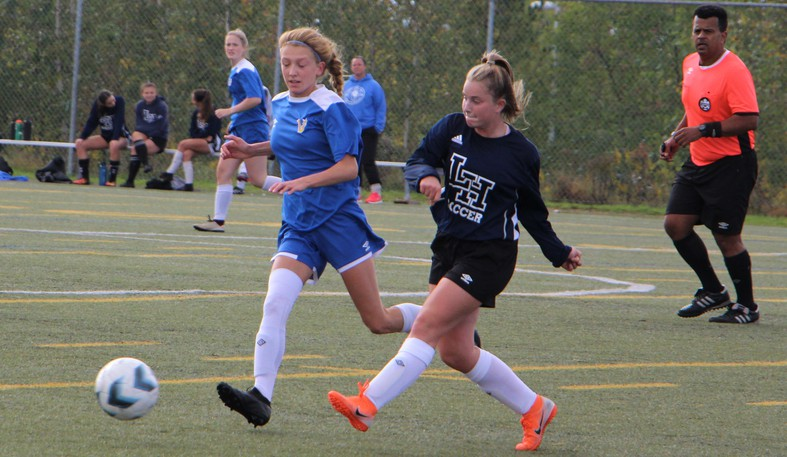 Nicole Ferguson, of the Leo Hayes Lions, moves the ball past a defender from Ecole Mathieu-Martin Vedettes during Saturday action at the inaugural Leo Hayes Varsity Girls Soccer Tournament.