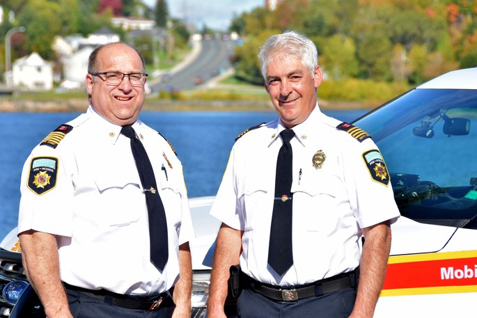 Bathurst's new fire chief, Danny Boucher, right, is seen with outing chief Marc Arseneault.