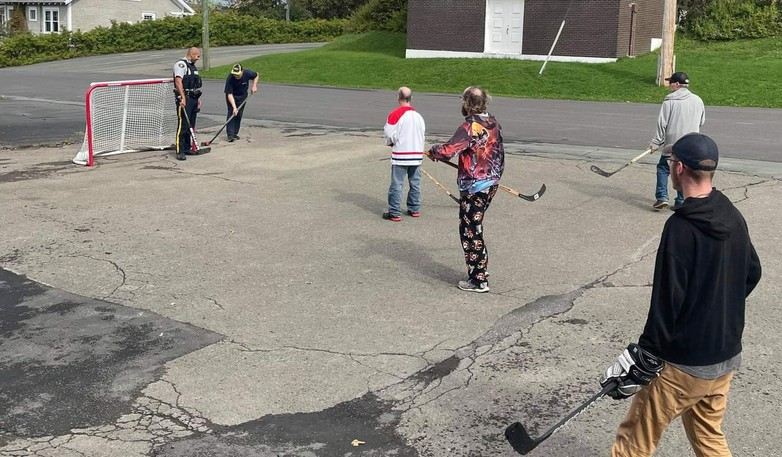 Const. Antony El-Khoury of the Campbellton RCMP created a stir when he stopped to play some street hockey with residents of Charest Special Care Home Sunday afternoon.