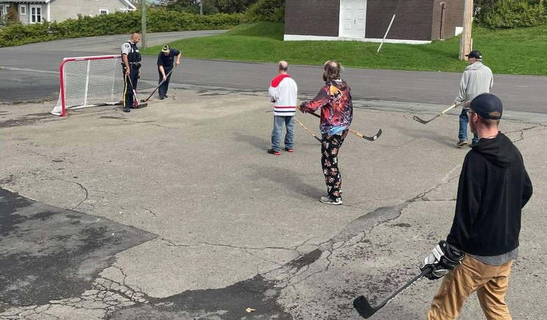 Const. Antony El-Khoury of the Campbellton RCMP stopped to play some street hockey with residents of Charest Special Care Home Sunday afternoon.