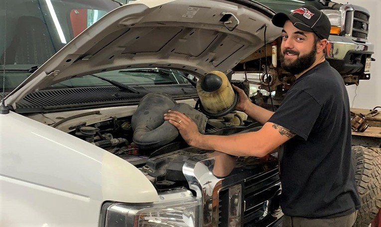 Luc McLaughlin, who's been a mechanic for 12 years, has opened his own automotive repair shop in the garage next to his Geary home.