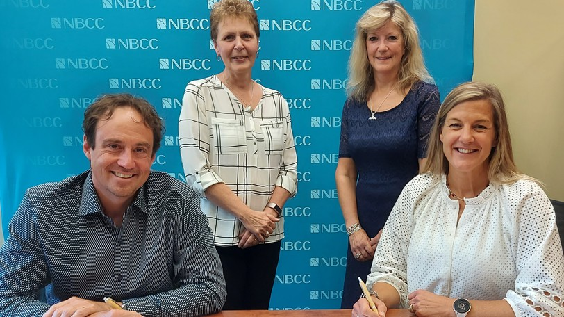 Officials with the Excellence in Manufacturing Consortium met with NBCC leadership in August to discuss a new Memorandum of Understanding. From left to right are: J.P. Giroux, president of EMC; Joan Richard, Operations Manager Eastern Canada for EMC; Ann Drennan, Vice President Academic and Research at NBCC; and Mary Butler, President and CEO of NBCC.