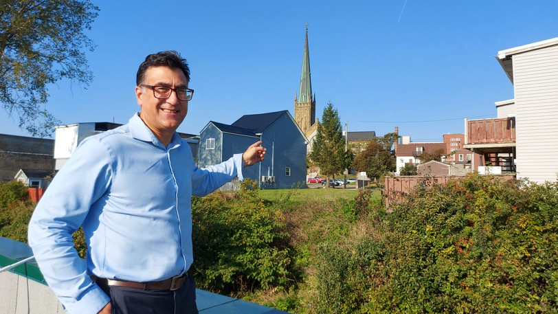 From the rooftop of the Social Enterprise Hub, Seth Asimakos, general manager of the Saint John Community Loan Fund, points out the location of a proposed supportive housing project at the corner of Waterloo and Richmond streets.