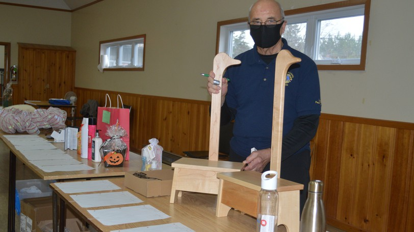 The Tobique Lions Club will hold its annual silent auction on Saturday, Oct. 23 at the Tobique Lions Community Centre in Plaster Rock with more than 100 items up for bids. Lion Paul Greer helped keep last year's event running smoothly.