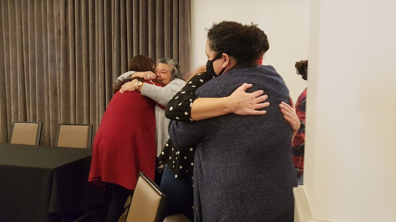 Rodney Levi's sister Rhoda Levi (right) hugs family friend Katie O'Shea after hearing members of a five-member coroner's jury deemed the fatal police shooting of her brother a homicide. Levi's cousin Marie Levi can also be seen hugging friend Shelley Francis.