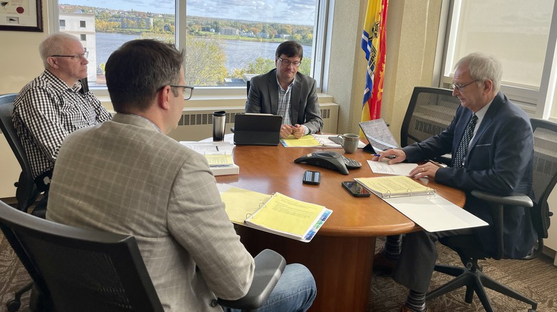 Intergovernmental Affairs Deputy Minister Cade Libby and assistant deputy Charles Ayles, chief of staff Louis Leger and Premier Blaine Higgs are pictured speaking with Prime Minister Justin Trudeau by phone on Friday.