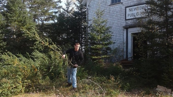 Steven Tingley is pictured cleaning up the property around the Newtown Public Hall, in preparation for the launch of the Newtown Farmers Market.