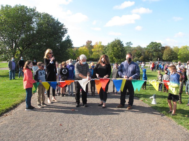 Andrea McAllister, Beth Johnson and Amy Adams of the Home and School association, joined Sussex Corner Mayor Wayne Wilkins, Sussex-Fundy-St. Martins MLA Tammy Scott-Wallace and Fundy Royal MP Rob Moore to unveil a new track at the Sussex Corner Elementary School.