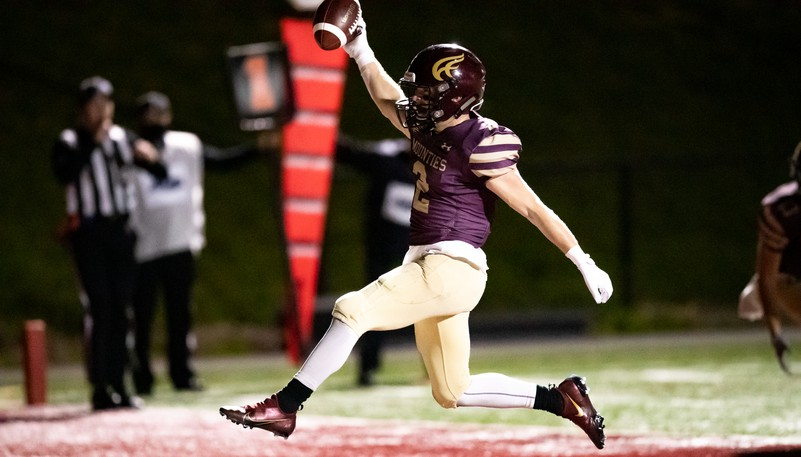 Mount Allison Mounties' Aidan O'Neal scores a touchdown during an AUS football game against the St. Francis Xavier X-Men on Friday at Alumni Field in Sackville.