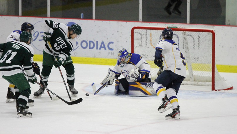 Université de Moncton Aigles Bleus goaltender Emile Samson keeps his eyes on the puck during an AUS men's hockey game against the University of Prince Edward Island Panthers on Saturday at the J.-Louis-Levesque Arena. UPEI players Danil Antropov (No. 92) and T.J. Shea (81) are in front of the net while UdeM defenceman Alexandre Bernier, right, skates in to help his goalie.