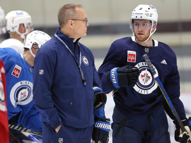 Andrew Copp (right) asks a question of head coach Paul Maurice during Winnipeg Jets training camp at BellMTS Iceplex in Winnipeg on Tues., Oct. 5, 2021.