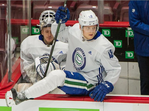 Vancouver Canucks Olli Juolevi jumps over the boards in a scrimmage game at Rogers Arena in Vancouver, BC, January 6, 2021.
