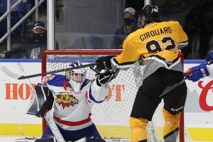 Charles-Antoine Pilote (20) and Jonas Taibel (40) of the Moncton Wildcats battle with Jack Campbell of the Cape Breton Eagles during Quebec Major Junior Hockey League action Sunday at Centre 200 in Sydney, N.S.