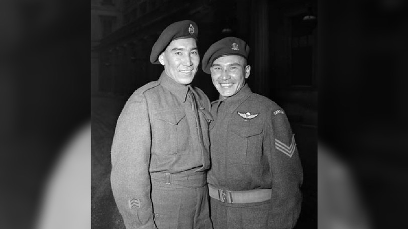Sgt. Tommy Prince, Canada's most decorated Indigenous war veteran, seen at right in a 1945 photo, is to be the subject of a Remembrance Day stamp in 2022.