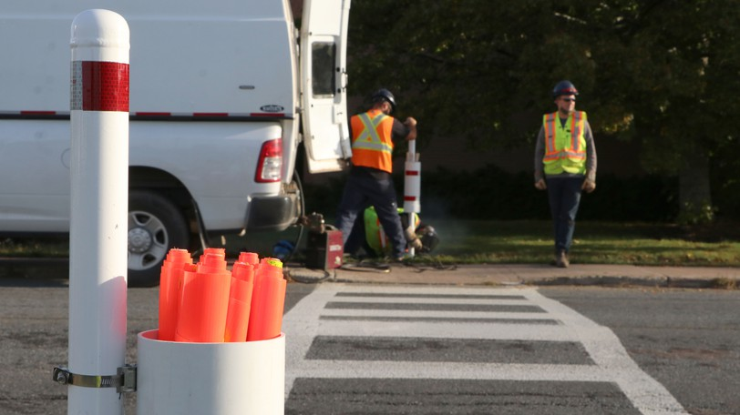 A six-month pilot project using flags to help pedestrians at crosswalks become more visible to motorists got underway in Amherst on Tuesday.
