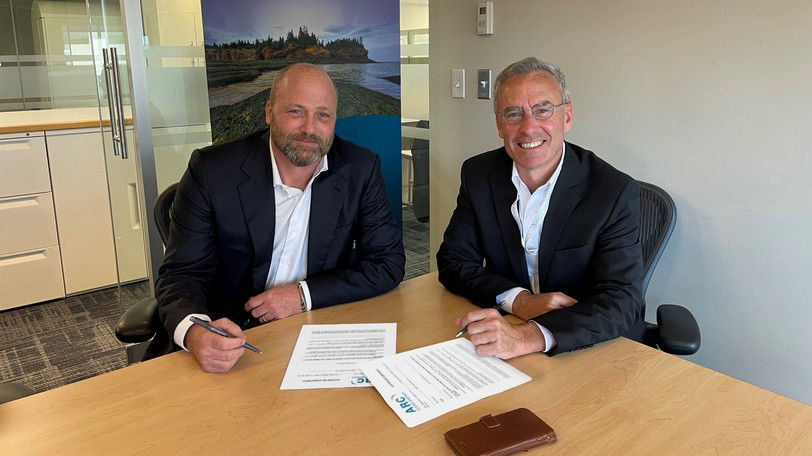 ARC Canada president and CEO William Labbe, right, and Cross River Infrastructure CEO Andrew Wilder are pictured signing a new partnership agreement.