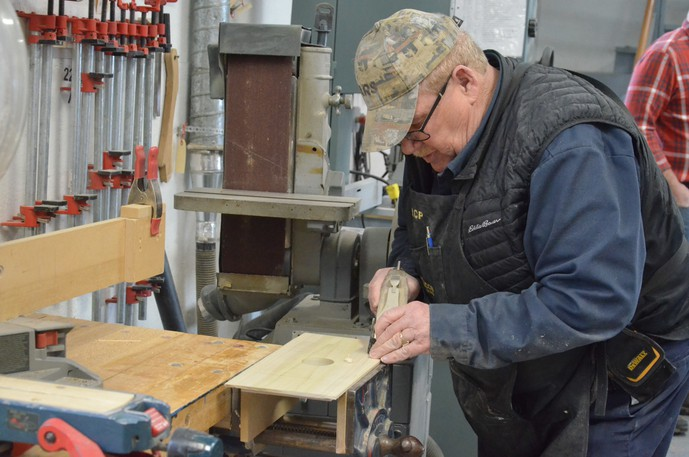 Ron Parks works on a project with the Miramichi Senior Sawdust Makers in 2020 in the W.S. Loggie Cultural Centre carriage house The woodworking group's shop lease is now up for renewal, with Miramichi city council scheduled to vote on it Oct. 19.